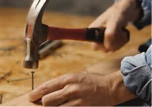Man Hammering in a Nail
