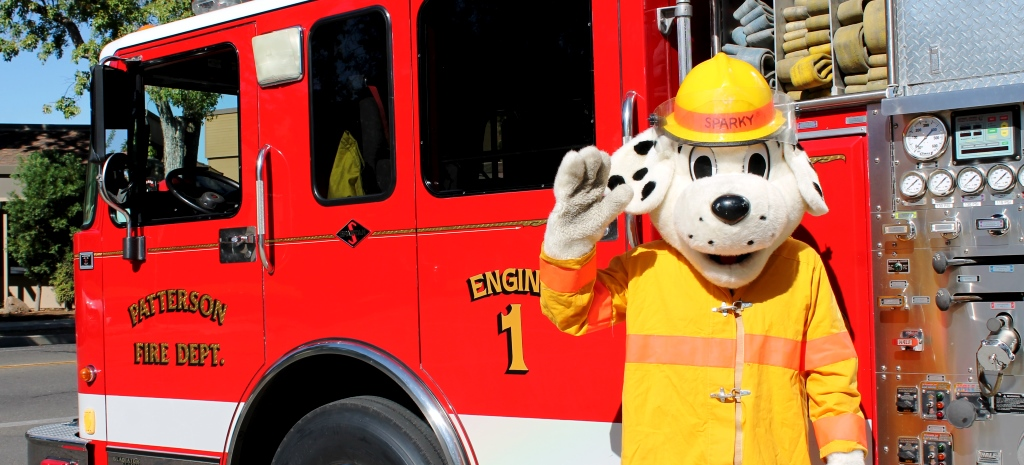 Sparky by a Fire Truck
